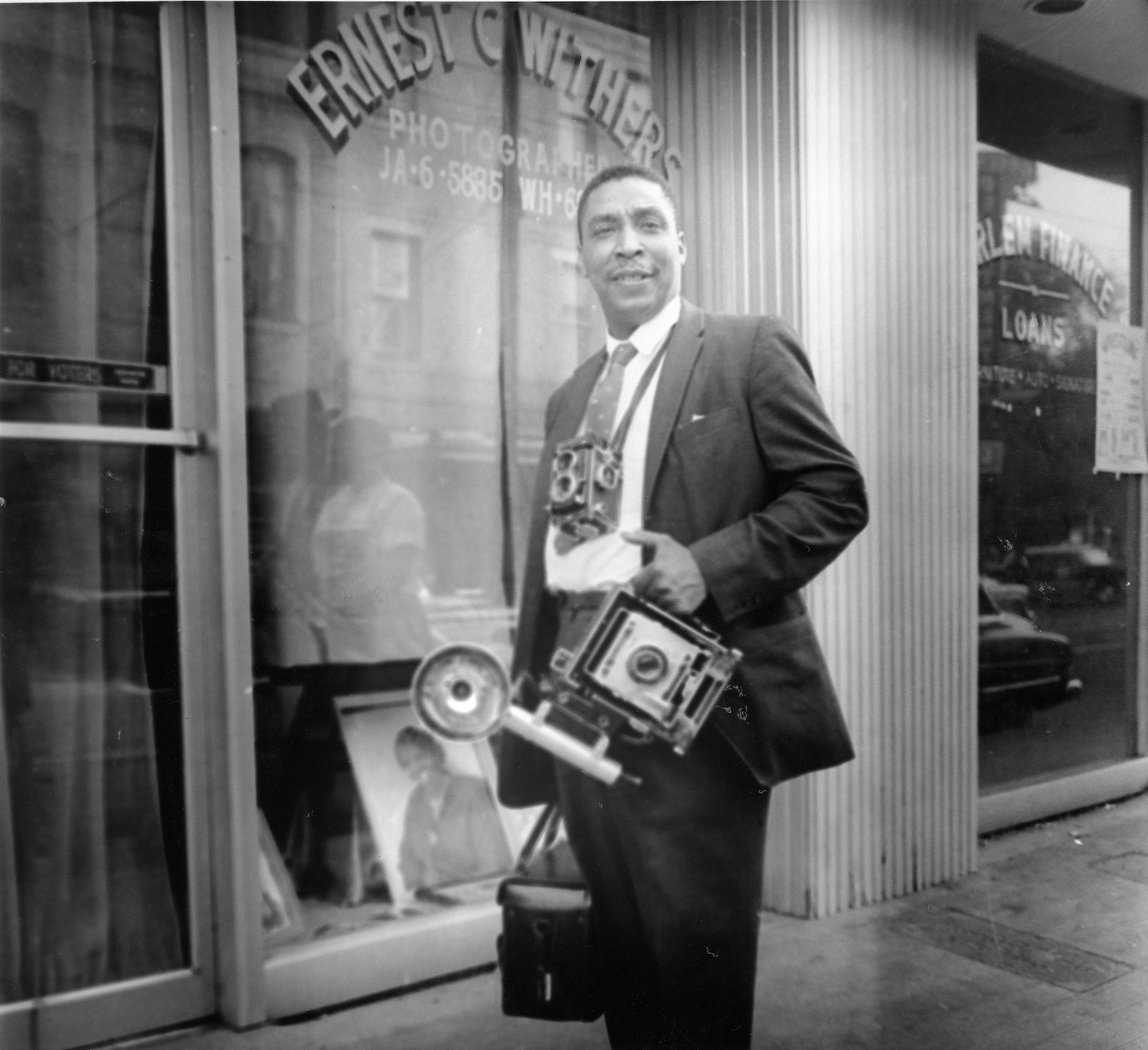 Ernest C. Withers standing outside his studio in Memphis